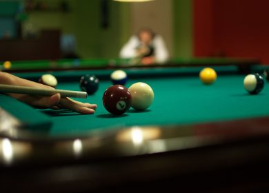 Pool table with balls on it