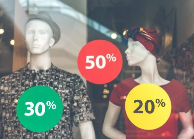 Mannequins with percentage tags in front of them