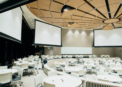 Conference room with circular tables and big screens