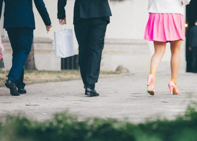 Three people's legs walking away from the camera