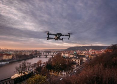 Drone over a hillside with a city in the background