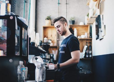 Man standing at a counter of a cafe